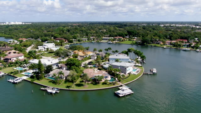 Aerial view of luxury villas and the private boat, florida Aerial view of luxury villas and the private boat in Bay Island neighborhood, Sarasota, Florida, USA mansion stock videos & royalty-free footage