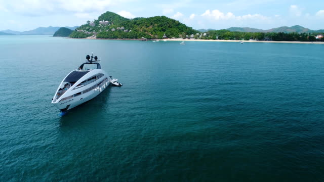 Aerial view of luxury yacht standing in the sea. Aerial view of luxury yacht standing in the sea near the beach. Thailand. military private stock videos & royalty-free footage