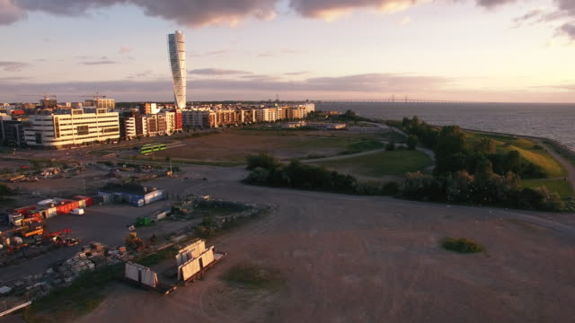 aerial view of malmo city buildings at sunset. industrial, construction area - post modern architecture stock videos & royalty-free footage