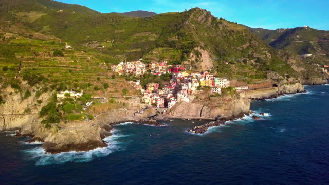 Aerial view of Manarola village on cliff rocks and turquoise sea. Stunning view of beautiful and cozy town in Cinque Terre Reserve, Liguria, Italy, Europe. Travel destination, adventure concept Aerial view of Manarola village on cliff rocks and turquoise sea. Stunning view of beautiful and cozy town in Cinque Terre Reserve, Liguria, Italy, Europe. Travel destination, adventure concept. provence alpes cote d'azur stock videos & royalty-free footage