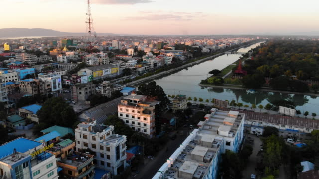 Aerial view of Mandalay, at sunset, Myanmar Cityscape at sunset myanmar stock videos & royalty-free footage
