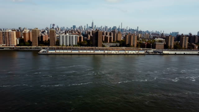 Aerial view of Manhattan bridge and district in New York, America. Drone turning on the shore of East river video