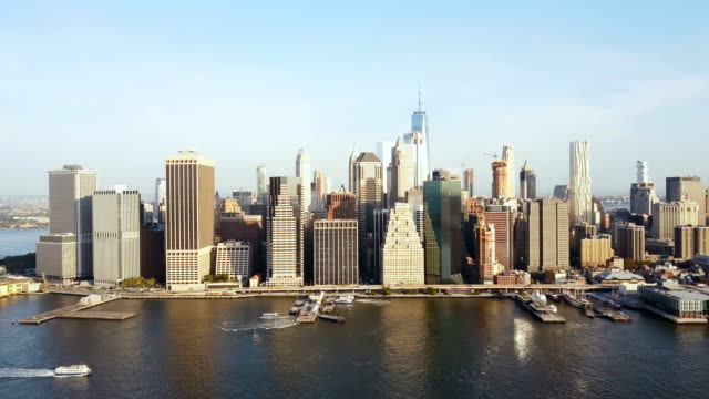 Aerial view of Manhattan district in New York, America. Drone flying along the shore of East river, downtown view video