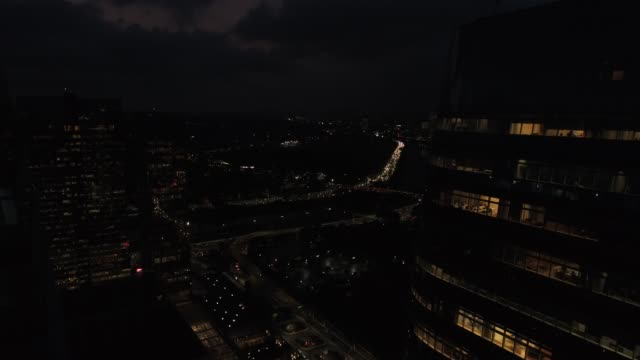Aerial view of Many Buildings and Traffic at Sao Paulo city, Brazil at night Drone Footage marginal tiete highway stock videos & royalty-free footage