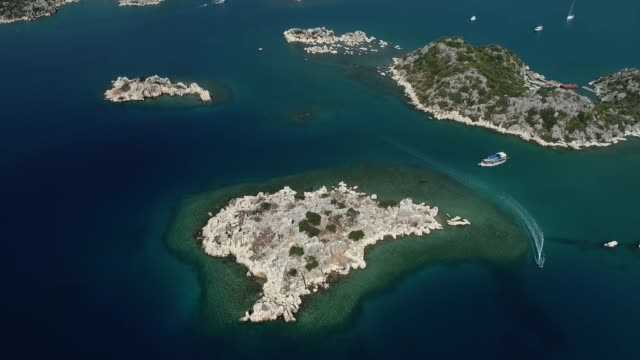Aerial view of many little island in the 'Kekova' town and Mediterranean seacoast/Antalya Antalya/Turkey 11/15/2018 Aerial view of many little island in the 'Kekova' town and Mediterranean seacoast/Antalya Antalya/Turkey 11/15/2018 old ruin stock videos & royalty-free footage