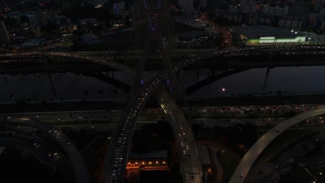 Aerial View of Marginal Pinheiros and Estaiada Bridge at night in Sao Paulo, Brazil Aerial View of Marginal Pinheiros and Estaiada Bridge at night in Sao Paulo, Brazil marginal tiete highway stock videos & royalty-free footage