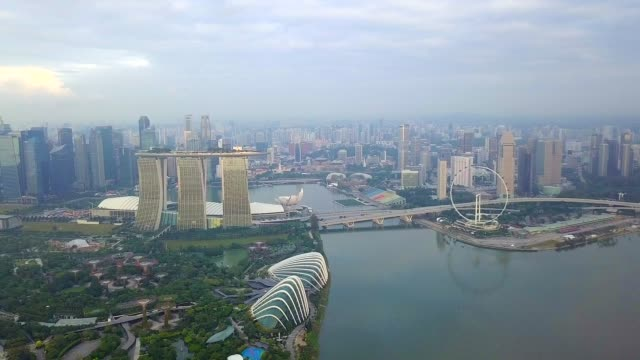 aerial view of marina bay sands revealing singapore city skyline - singapore architecture stock videos & royalty-free footage