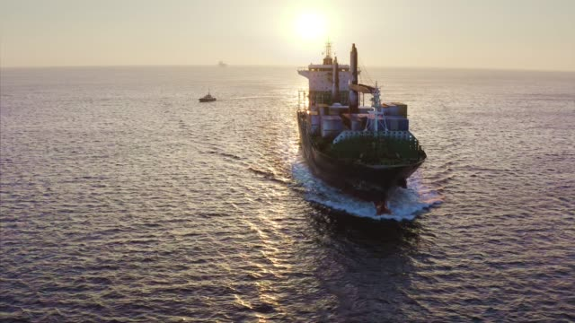 aerial view of massive cargo ship with containers sailing at sunrise.vladivostok - chiatta video stock e b–roll