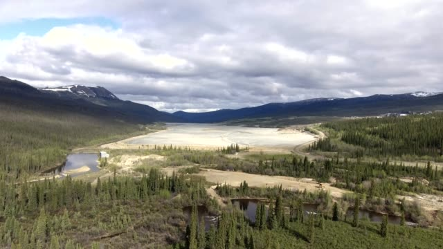 Aerial view of massive tailings pond at abandoned mine site in northern Canada