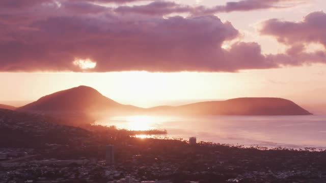 Aerial view of Maunalua Bay with Koko Crater in distance at sunset. Honolulu, Oahu, Hawaii circa-2018, Aerial view of Maunalua Bay with Koko Crater in distance at sunset. Shot with Cineflex and RED Epic-W Helium. oahu stock videos & royalty-free footage
