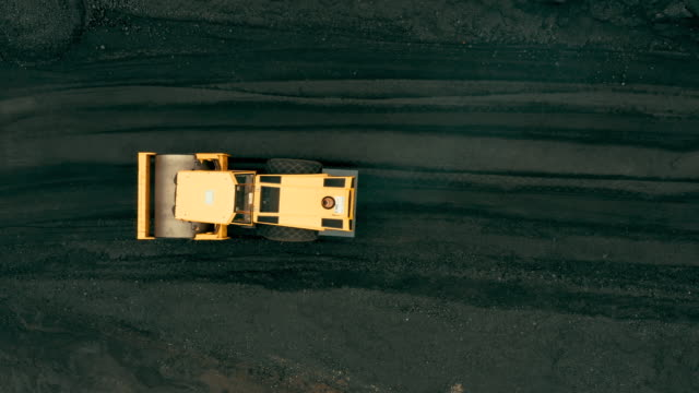Aerial view of Mechanical Digger in coal mining area Aerial view of Mechanical Digger in coal mining area construction machinery stock videos & royalty-free footage