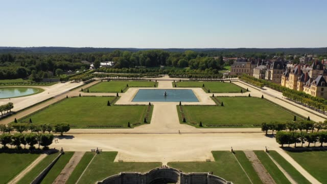 Aerial view of medieval landmark royal hunting castle Fontainbleau and lake with white swans, France Aerial view of medieval landmark royal hunting castle Fontainbleau near Paris in France and lake with white swans royalty stock videos & royalty-free footage