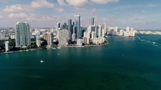 Aerial view of Miami downtown, Florida. Sunny day with boats on the ocean