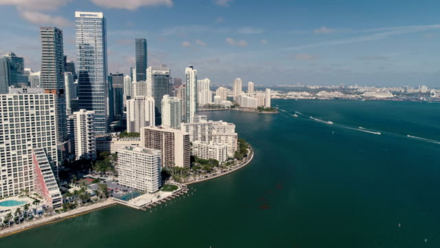 Aerial view of Miami downtown skyscrapers, Florida. Sunny day with boats on the ocean