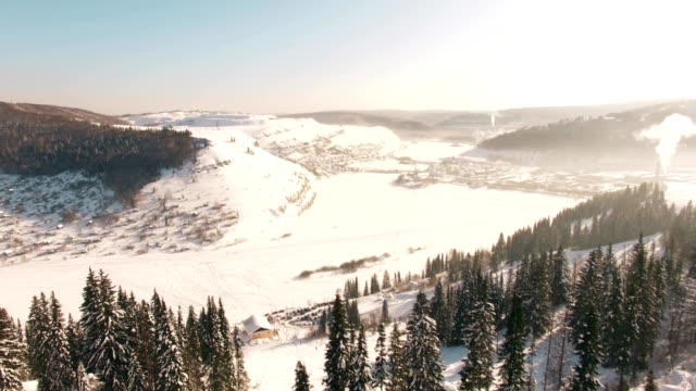 aerial view of minyar city in chelyabinsk region at winter - monti urali video stock e b–roll
