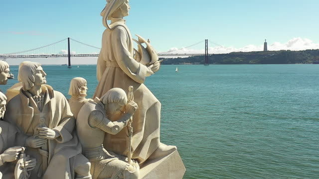 aerial view of monument to the discoveries in balem district lisbon portugal - lisbona video stock e b–roll