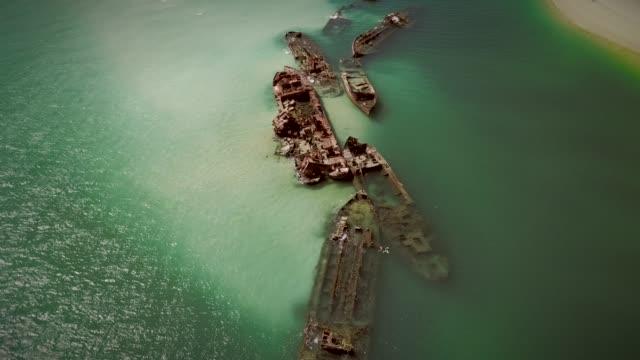 aerial view of moreton island shipwrecks in australia. - кораблекрушение стоковые видео и кадры b-roll