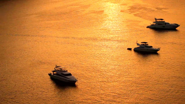 Aerial view of motor boats at the sea in sunset time