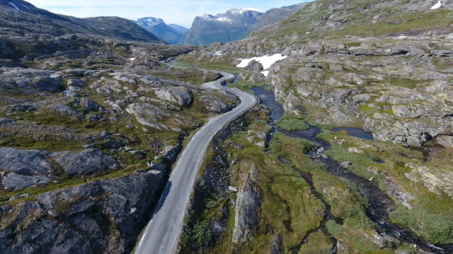 aerial view of mountain and road to dalsnibba, travelling caravan, norway - caravan stock videos & royalty-free footage