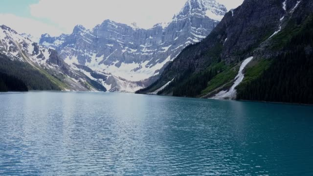 Aerial view of mountain lake and glacier in Canada video