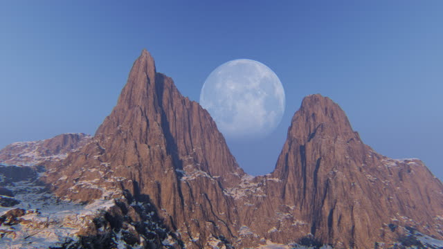 Aerial view of mountain peak with moon