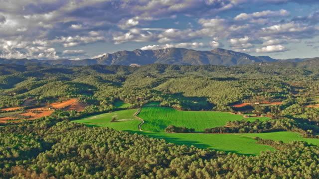 aerial view of mountain range in the pyrenees, catalonia, spain - paesaggio collinare video stock e b–roll