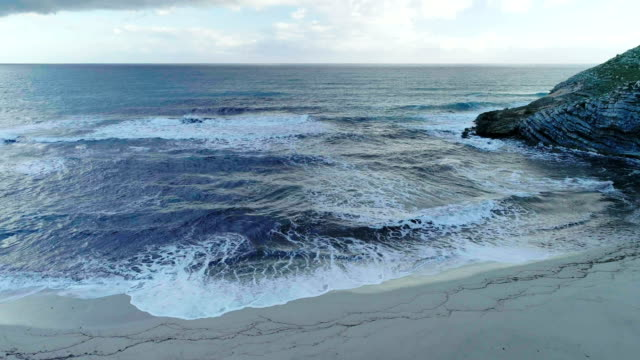 Aerial view of mountainous coastline. Foamy waves video