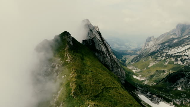 aerial view of mountains in fog  switzerland - пик стоковые видео и кадры b-roll