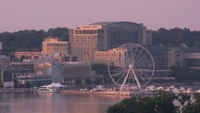 aerial view of national harbor and capital wheel. - capitello video stock e b–roll