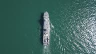 istock Aerial view of naval ship, battle ship, warship, Military ship resilient and armed with weapon systems, though armament on troop transports. support navy ship. Military sea transport. 1254951075