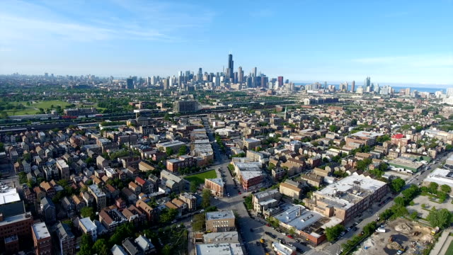 Aerial view of neighborhood and city skyline Aerial view of neighborhood homes with Chicago skyline and buildings chicago stock videos & royalty-free footage