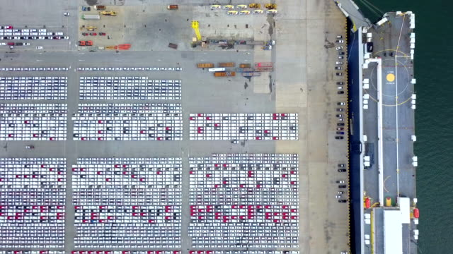 Aerial view of new car storage parking lot  Automobile export industry at deep water port video