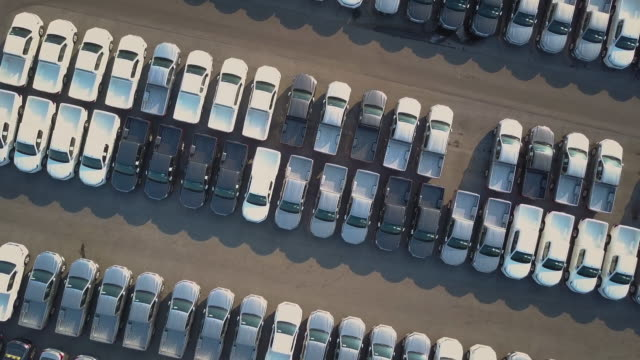 Aerial View of new cars for sale Aerial View of new cars for sale car dealership stock videos & royalty-free footage