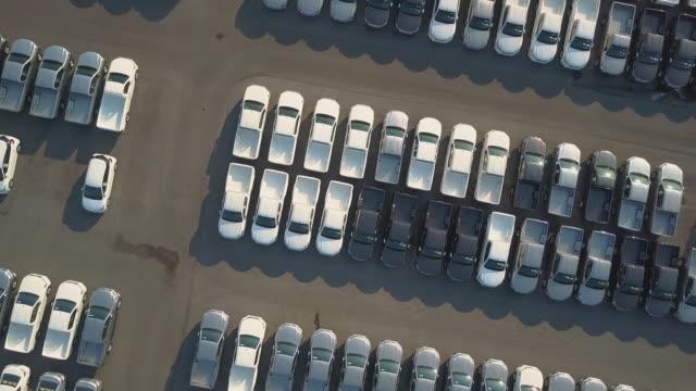 stockvideo's en b-roll-footage met luchtfoto van nieuwe auto's te koop - parking