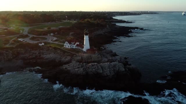 Aerial view of New England coastline and lighthouse (4k)