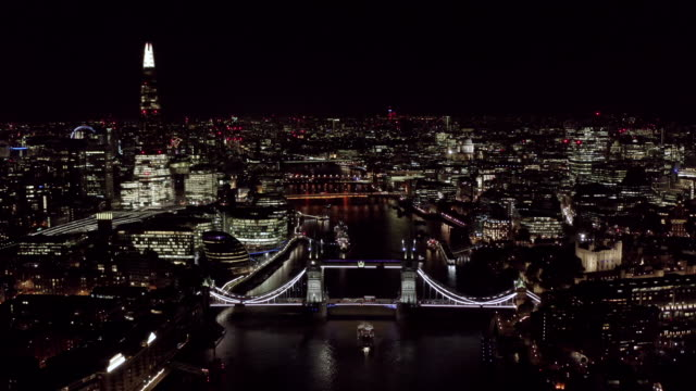 aerial view of new london cityscape and landmarks at night - londra video stock e b–roll