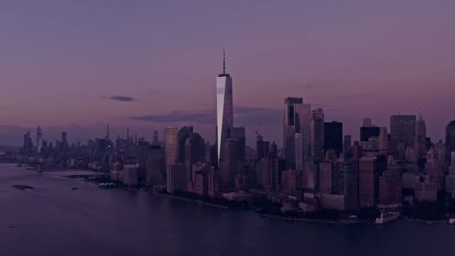 Aerial view of New York City at sunset with dramatic purple sky 4k