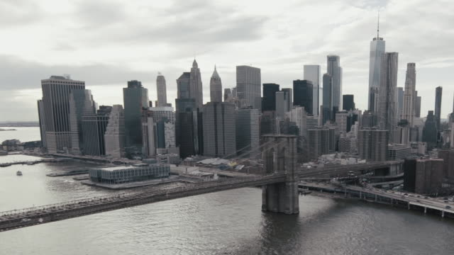 Aerial view of New York cityscape against sky