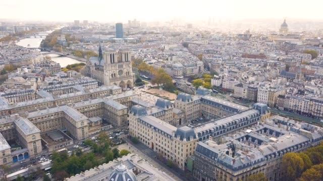 aerial view of notre dame de paris cathedral - parigi video stock e b–roll