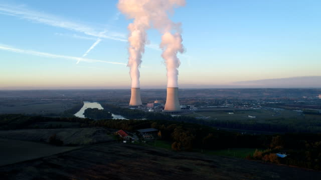 aerial view of nuclear power plant with sunset - reattore nucleare video stock e b–roll