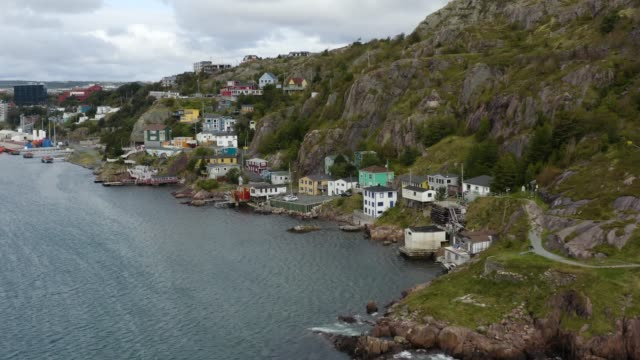 Aerial view of ocean and townhouses in newfoundland