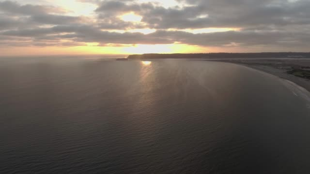 Aerial view of ocean in San Diego, CA during sunset video