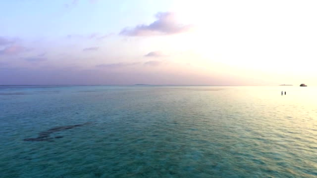 Aerial view of ocean, Maldives Drone is moving very fast forward, few steps above the surface of the ocean. View is stunning as in one moment you can see sun coming out behind an island. Drone is rotating to the other side, having horizon in his point of view. indian ocean stock videos & royalty-free footage