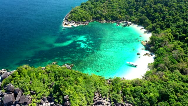 Aerial view of ocean waves, Beautiful tropical beach and rocky coastline and beautiful forest. Nga Khin Nyo Gyee Island Myanmar video