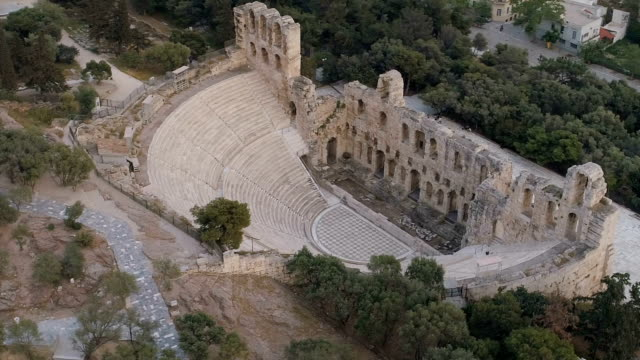 Aerial view of Odeon of Herodes Atticus and Acropolis of Athens ancient citadel in Greece video