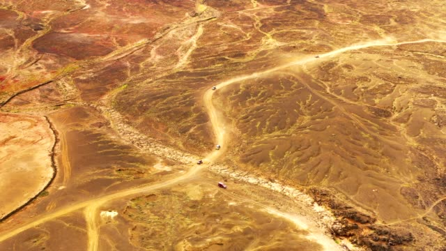 aerial view of off roads buggy on scenic rock formation trail, spain. - group of people filmów i materiałów b-roll