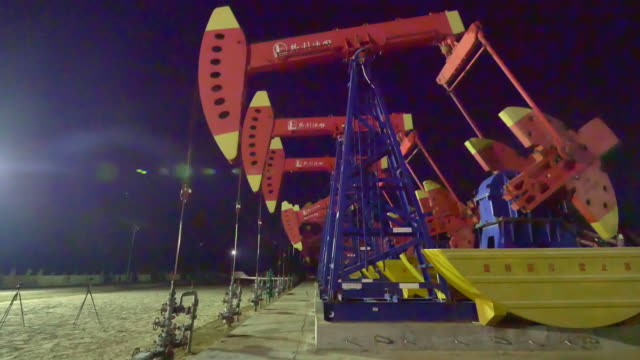 aerial view of oil field with pump units 4k video