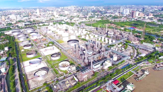 Aerial View of Oil Refinery near River, Bangkok, Thailand. Flying Around Chemical Plant with Complex Pipe in the Morning video