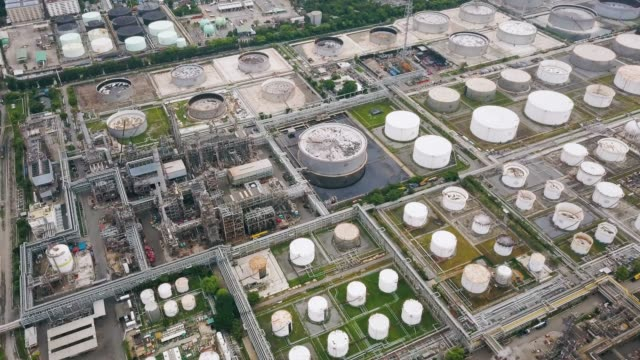 Aerial view of oil refinery plant Aerial view of oil refinery plant in southeast asia gas pipe stock videos & royalty-free footage