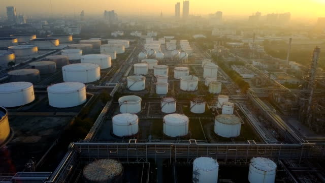 4K Aerial view of oil refinery plant with storage tank